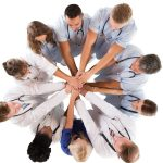 medical team joining hands